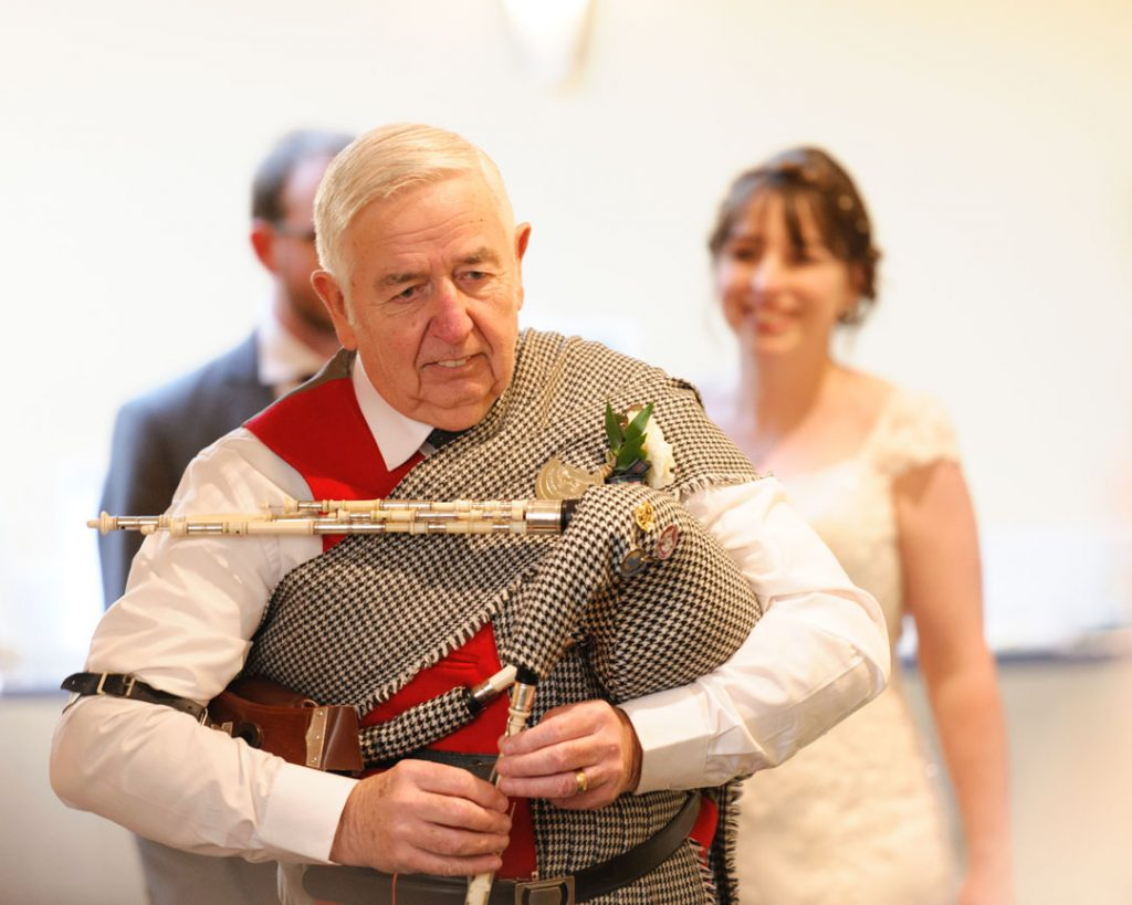 bagpiper at wedding reception