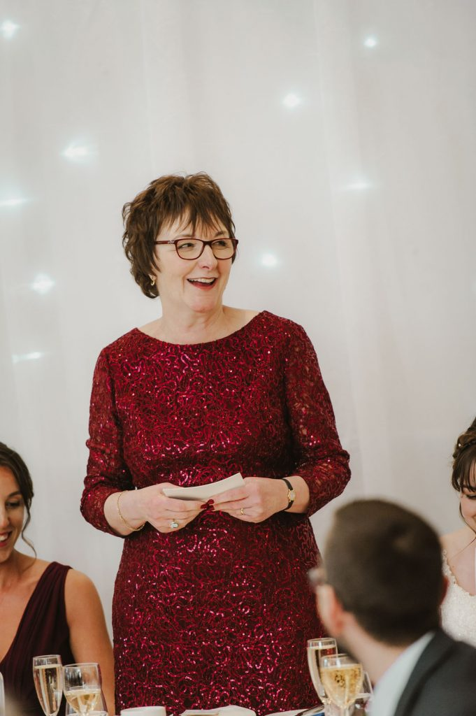 mother of the bride in red sparkling dress