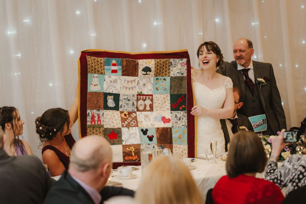 brides laughing at wedding gift