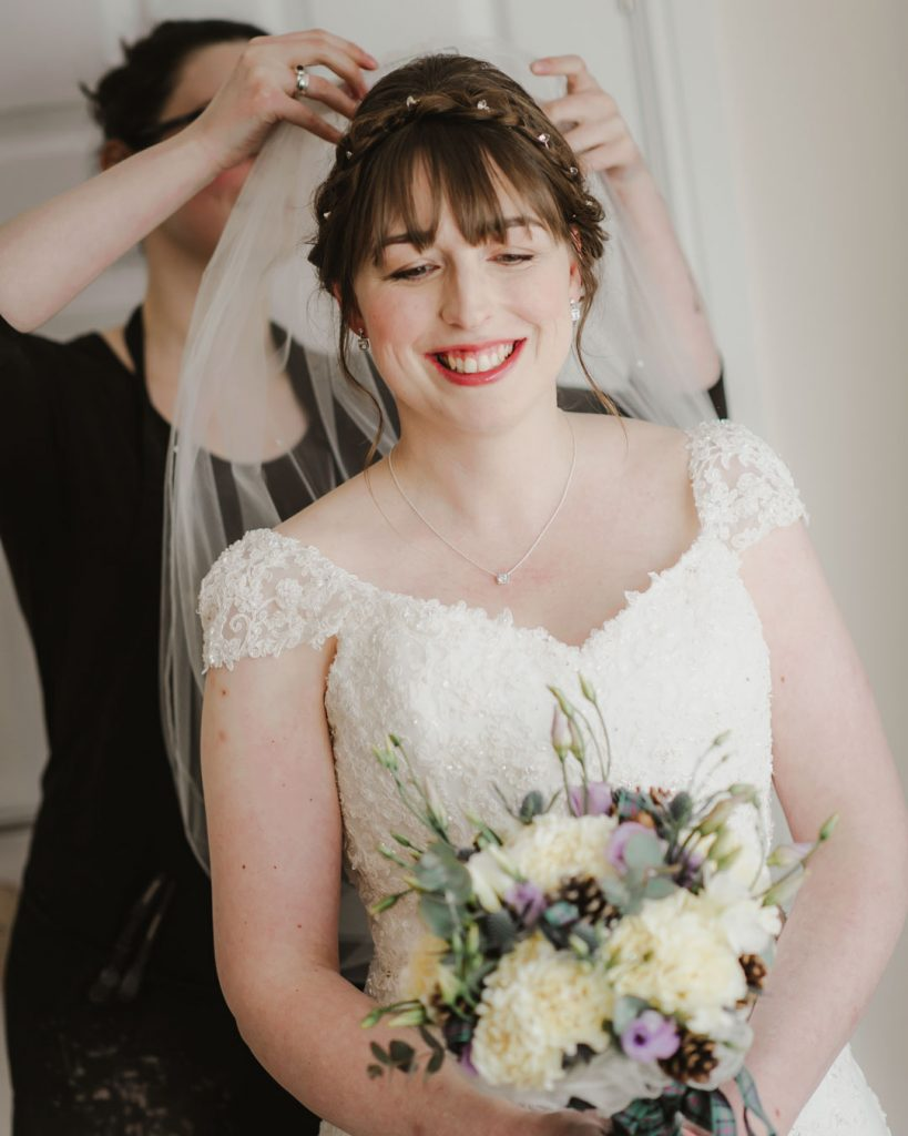wedding veil on brides head