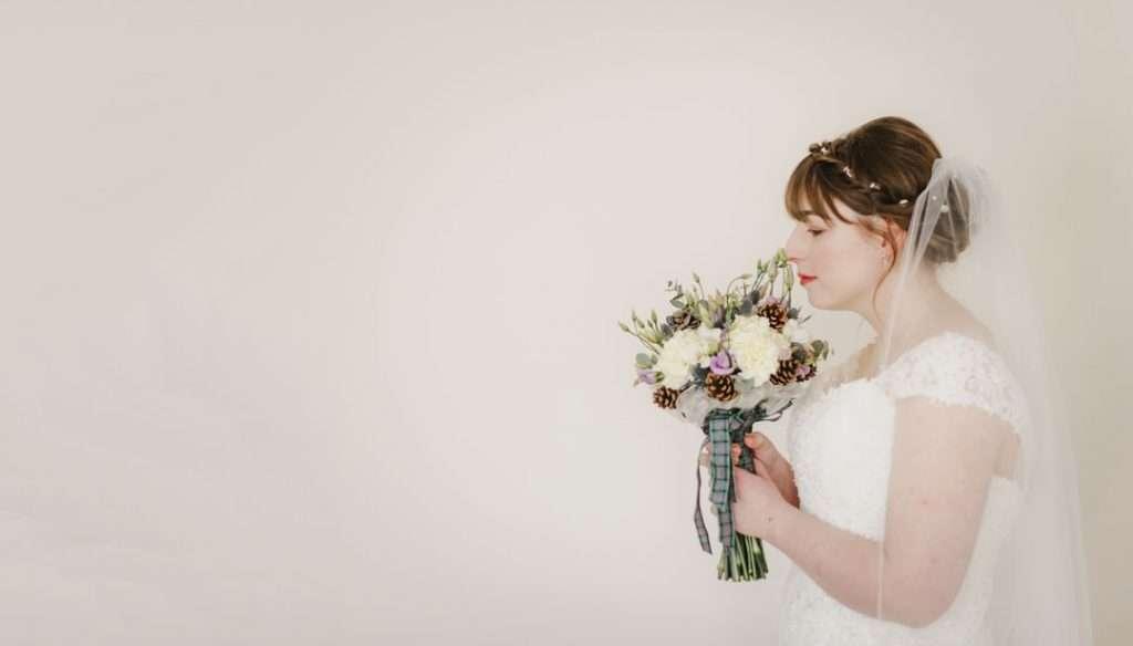 bride smelling wedding flowers