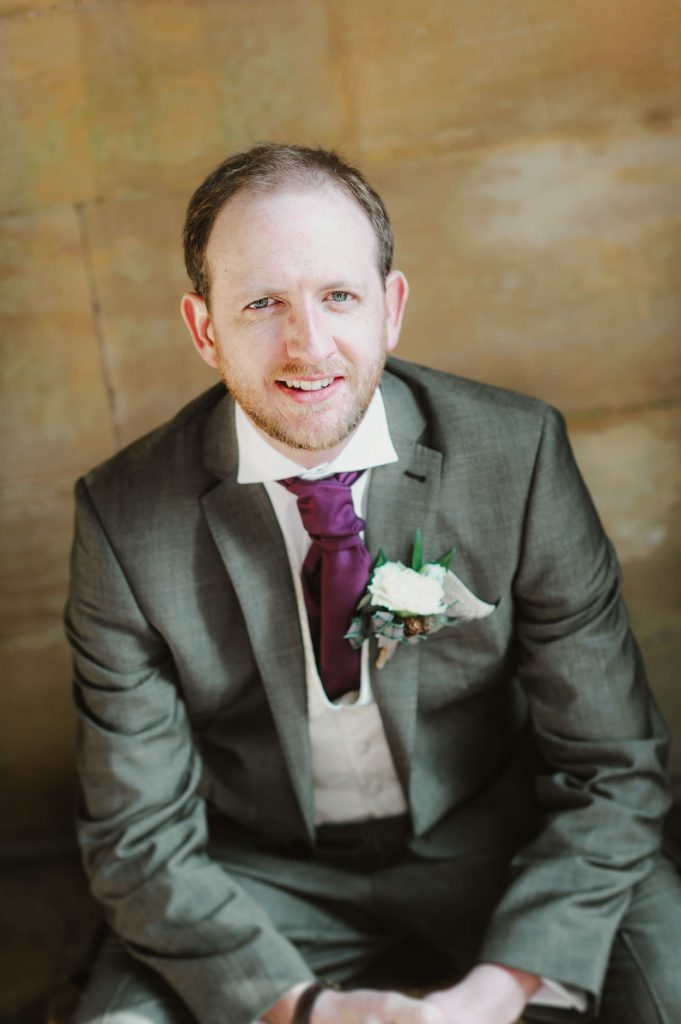 groom in purple tie