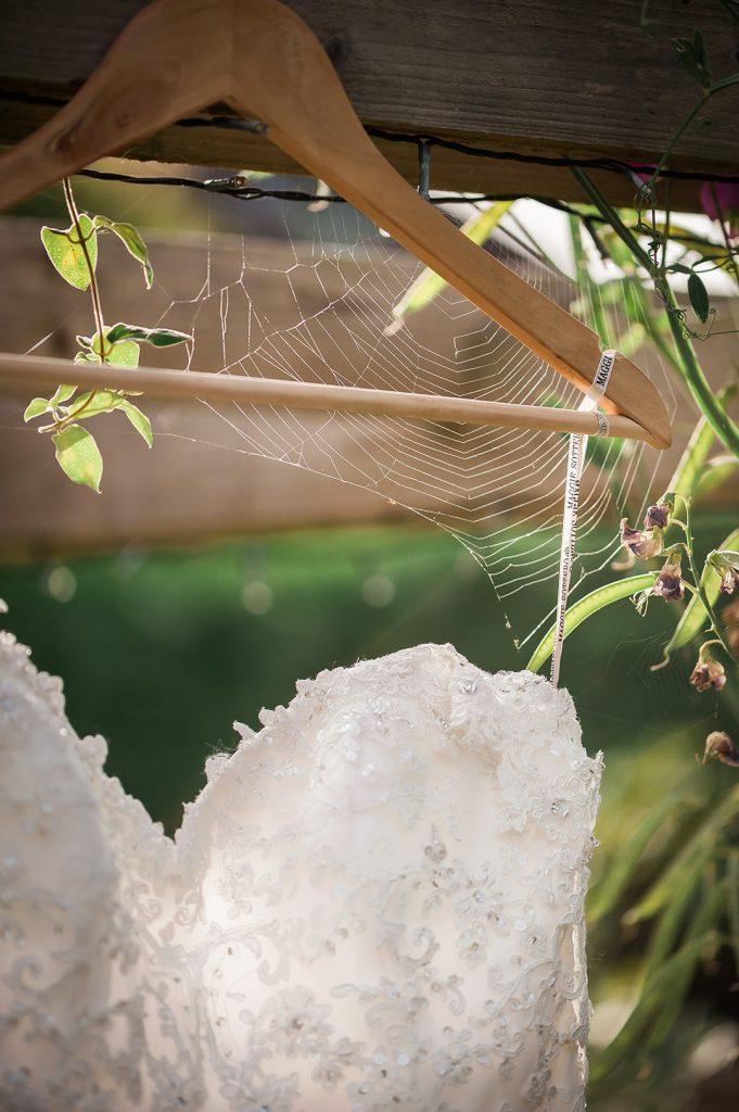 white wedding dress and spiders web