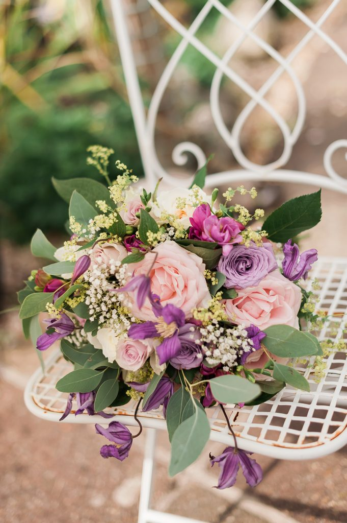 pink wedding bouquet on white chair