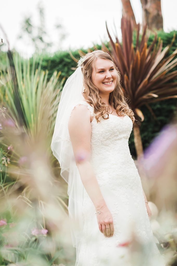 bride laughs in garden