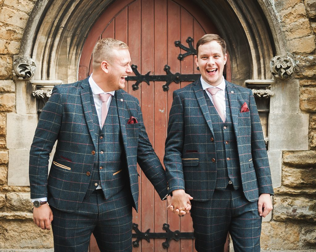 groom and bestman holding hands