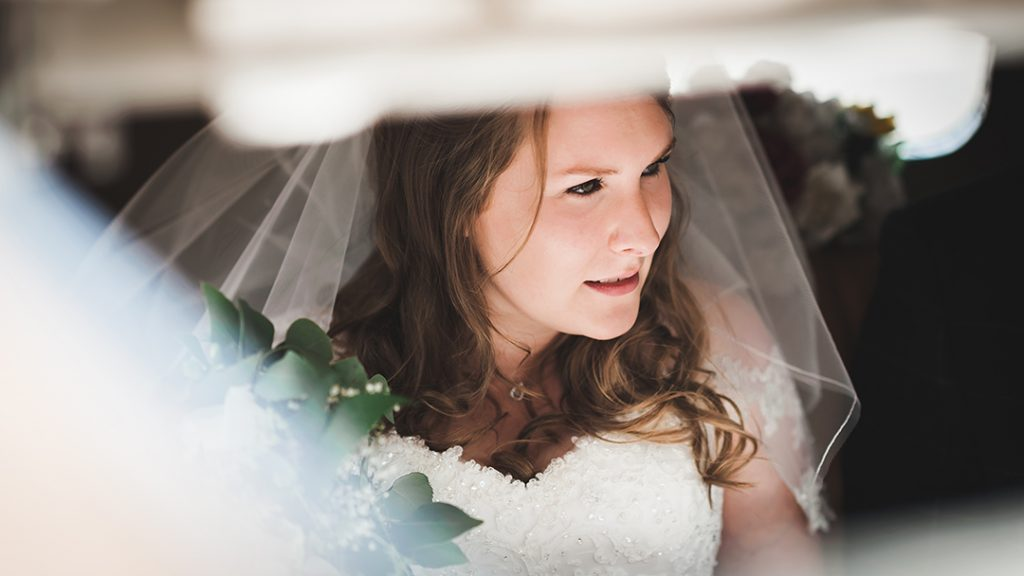 bride looking out of car