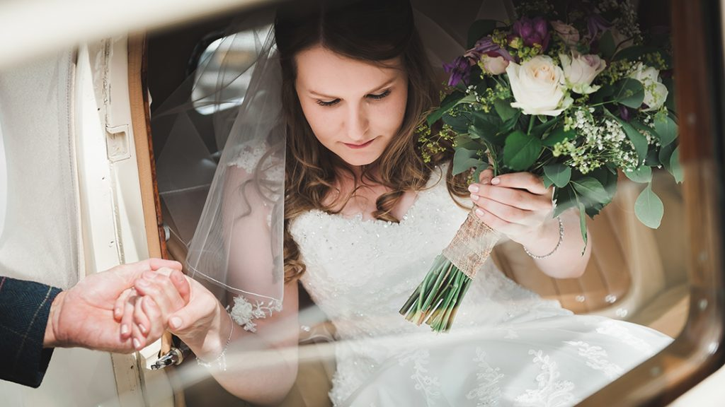 bride gets out of wedding car