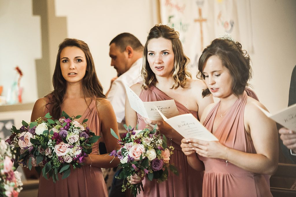 bridesmaids singing inside church