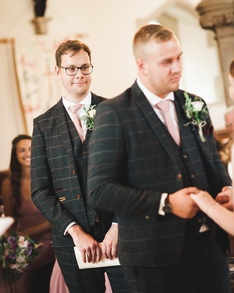 bestman in checked jacket and glasses
