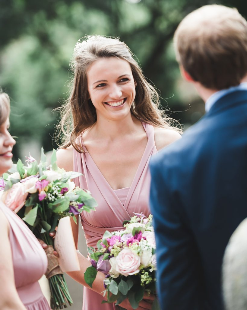 bridesmaid smiling in pink dress