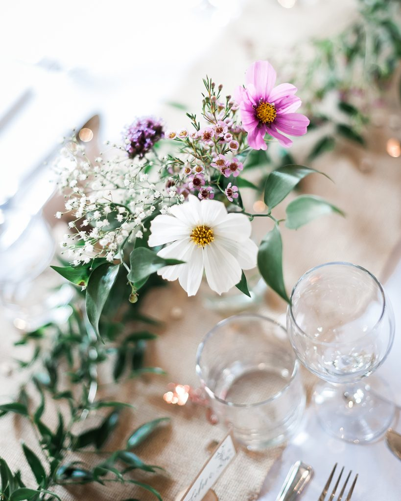 white and pink flowers at wedding table decoration