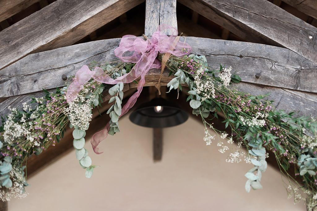 floral decoration in barn wedding pink ribbon