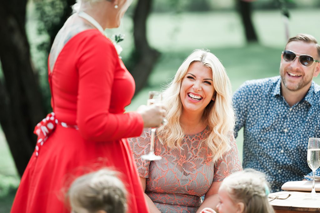 woman and man laughing at wedding reception