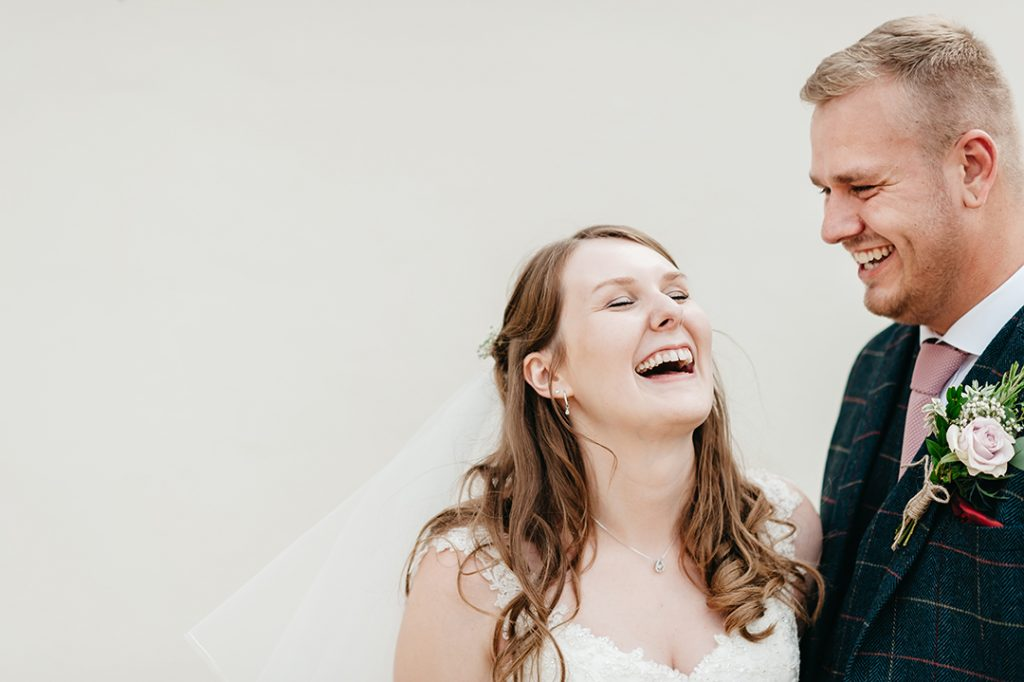 bride and groom laughing at Lincolnshire wedding