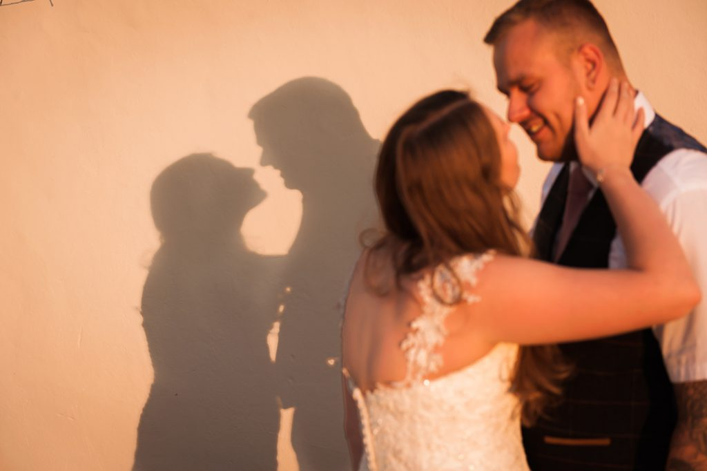 sunset wedding photography of bride and groom silhouette