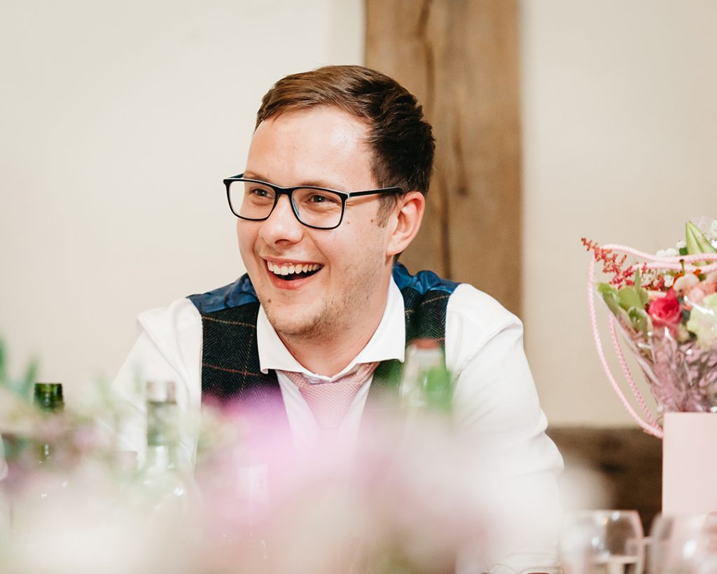bestmen wearing glasses laughing at speech