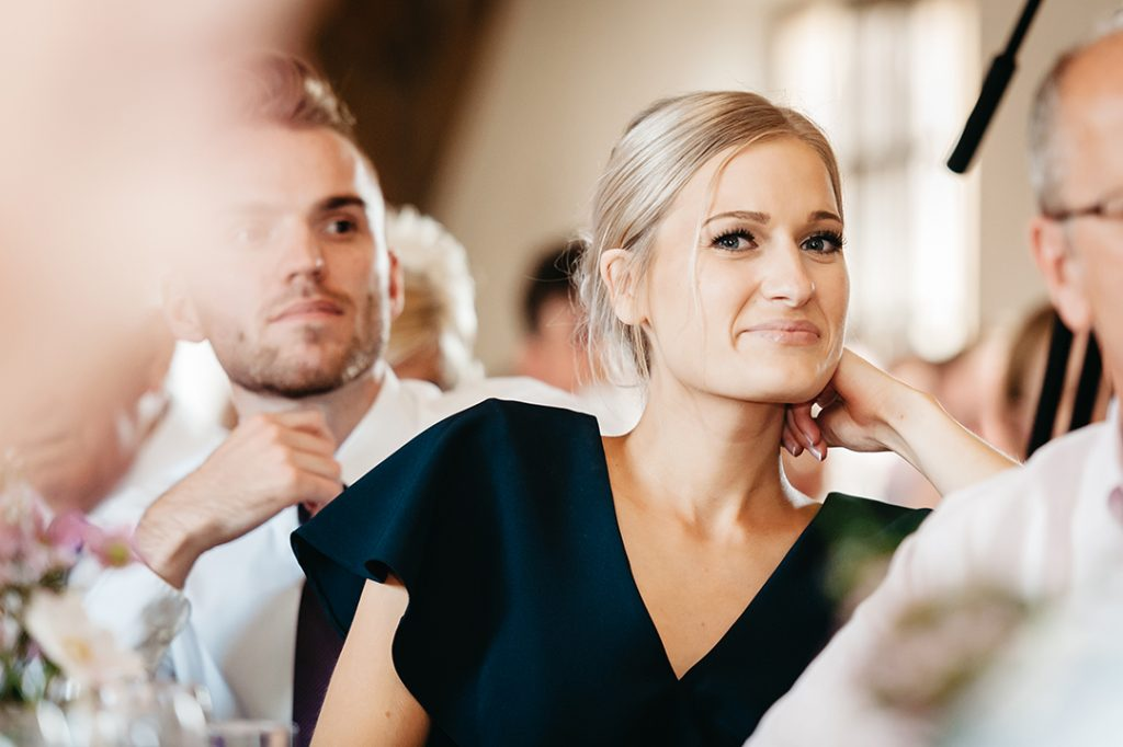 woman in blue dress smiling at wedding