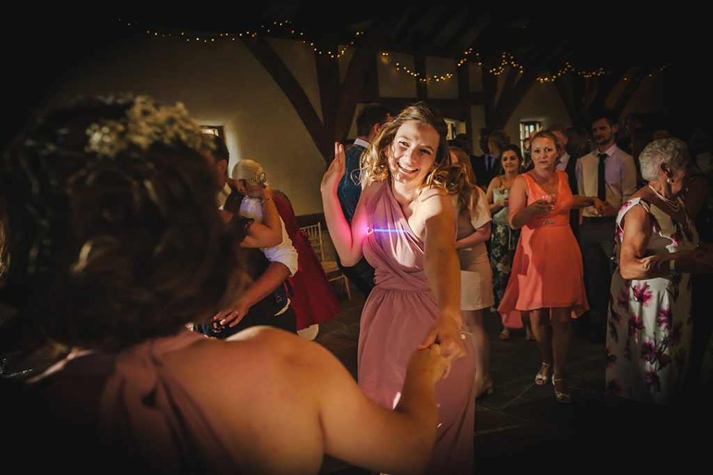 bridesmaid dancing at abbey farm wedding