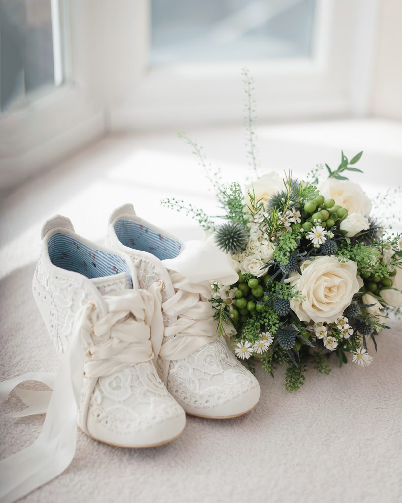 white wedding shoes with flowers