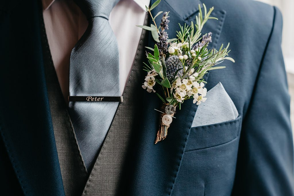 groom wearing button hole