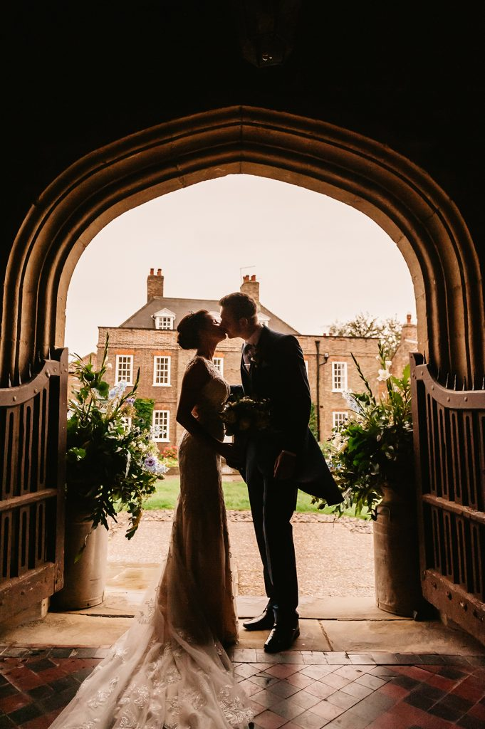bride and groom kiss outside church Alford