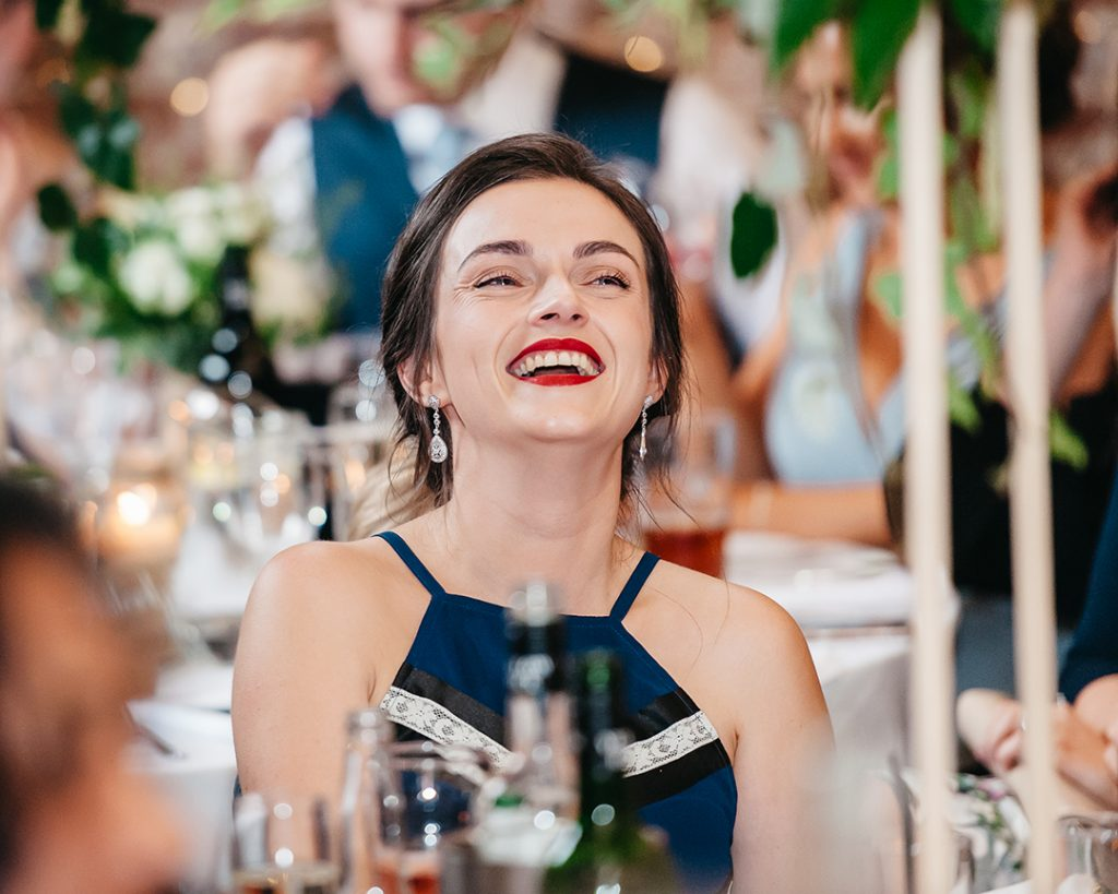 guest at wedding in blue dress and red lipstick