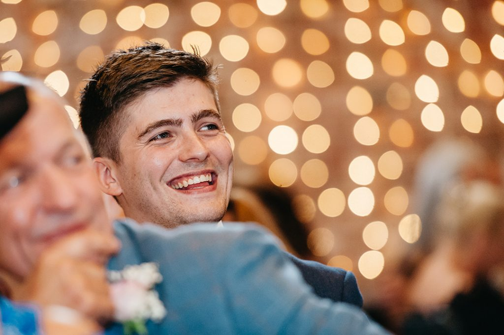 wedding guest with lights in background