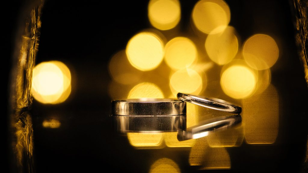 wedding rings reflected with blurred background