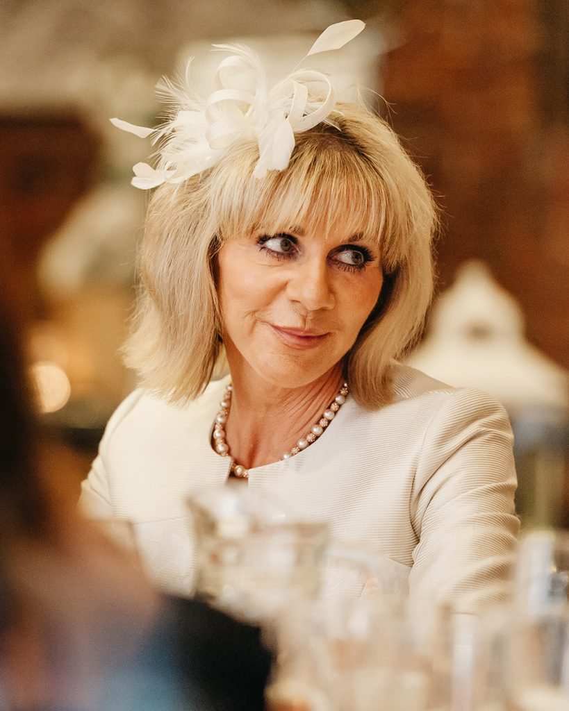 wedding guest wearing white fascinator
