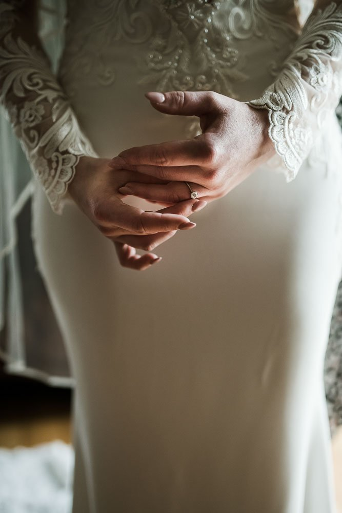 bride holding wedding ring