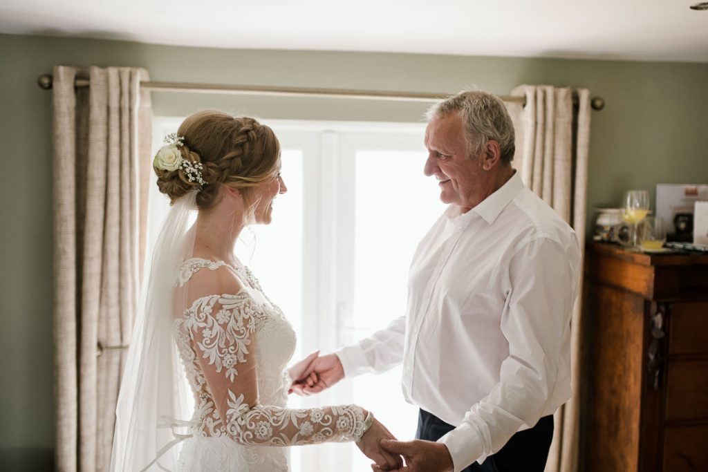 father and bride holding hands