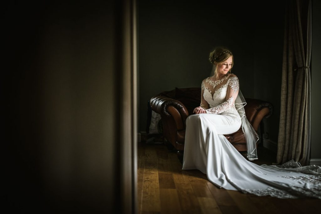 bride sat on chair near window light