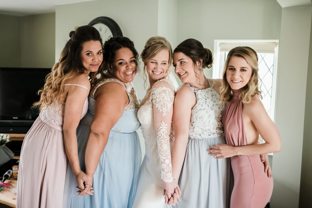bridesmaids and bride in a group