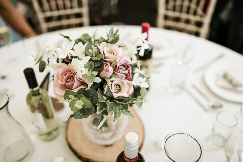 pink flowers on table at wedding
