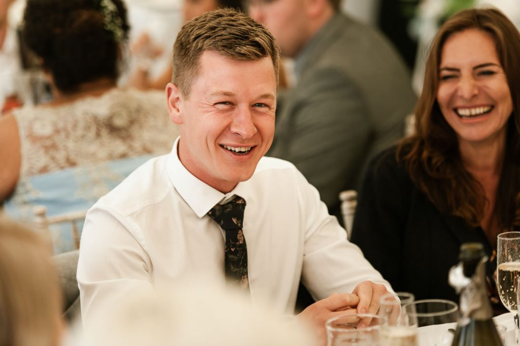 man in white shirt wedding guest