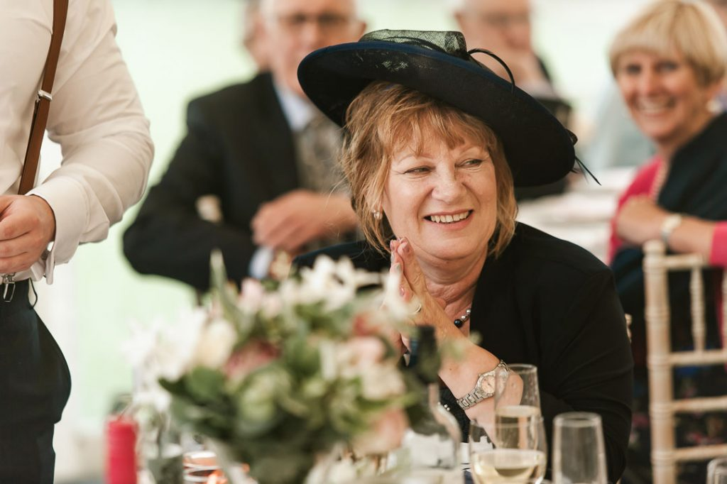 woman with black hat at wedding reception