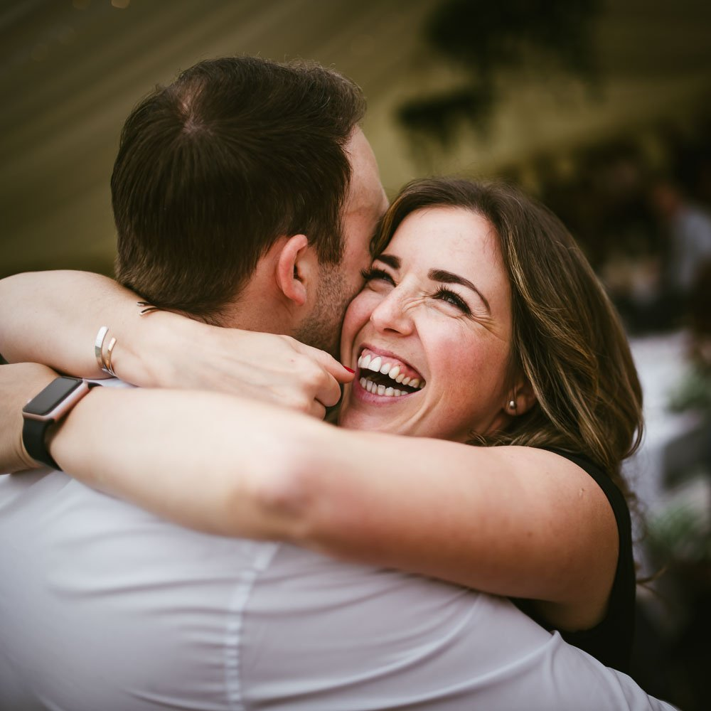woman hugs man laughing