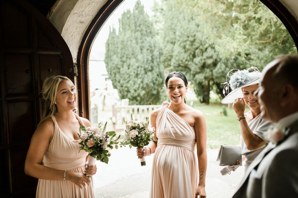 bridesmaid in peach dress laughing