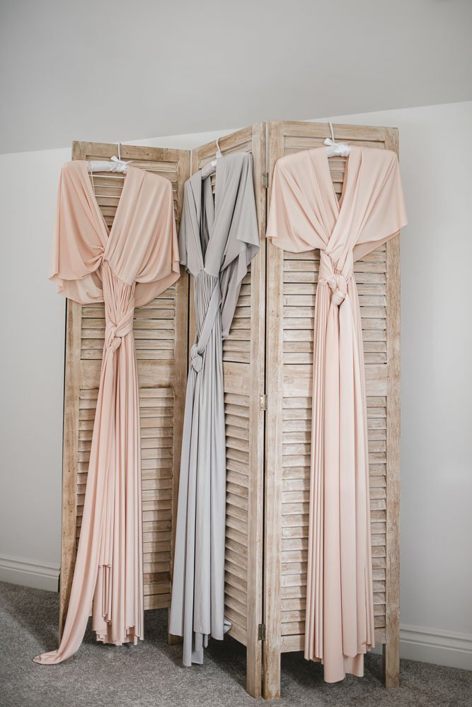 peach bridesmaid dresses hung up