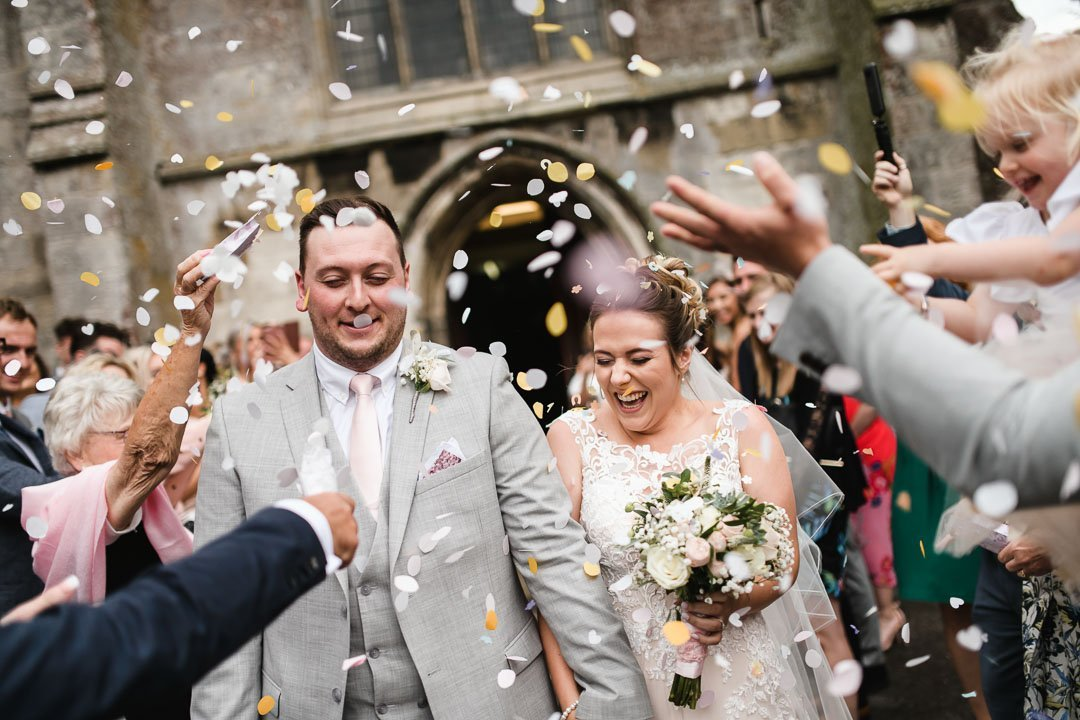 confetti thrown at bride and groom as they leave church