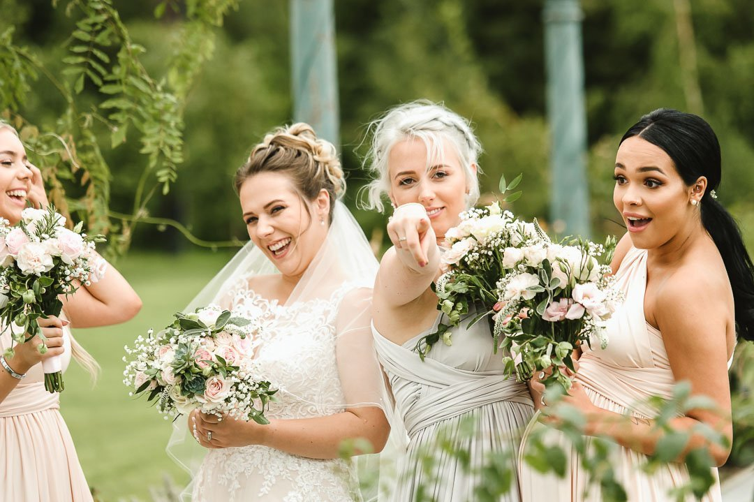 woman pointing at wedding photographer