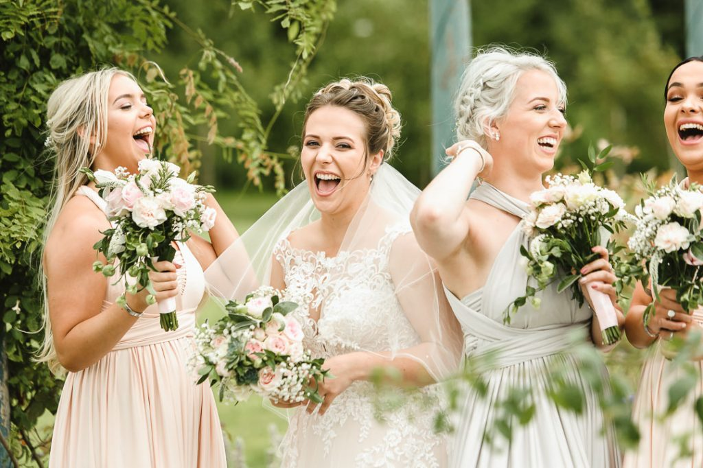 bride laughing at wedding photographer