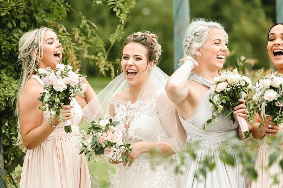 bride laughing at brackenborough hotel wedding photographer