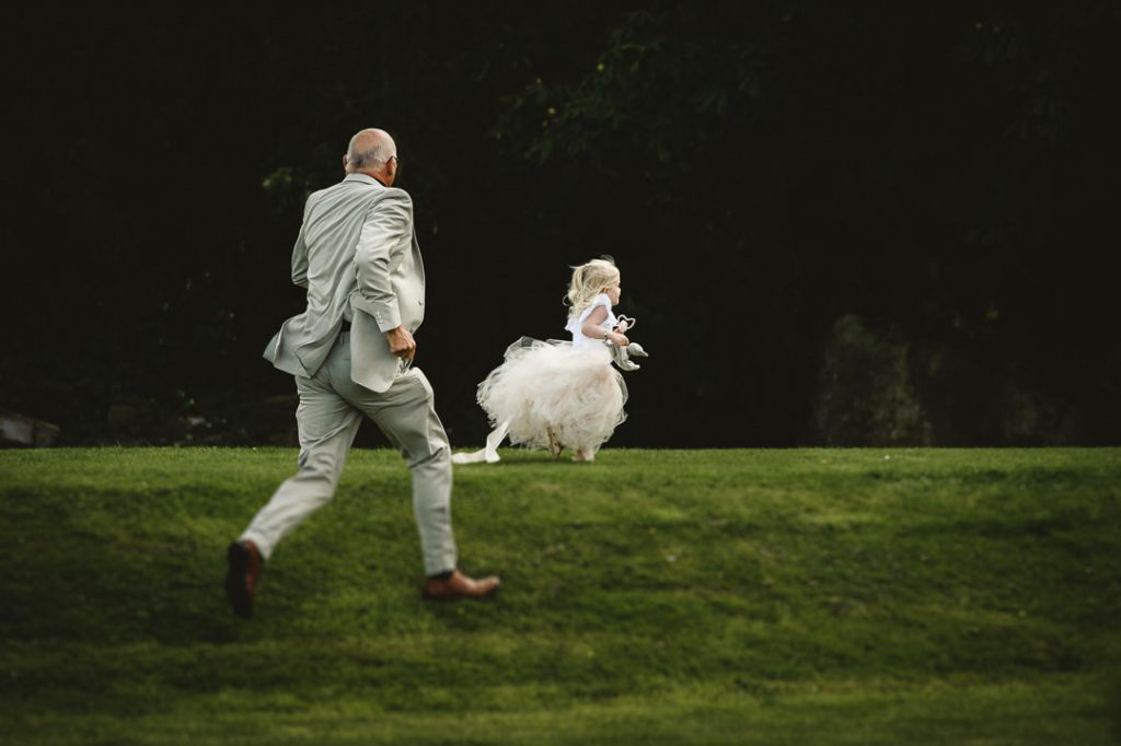 man running after flower girl