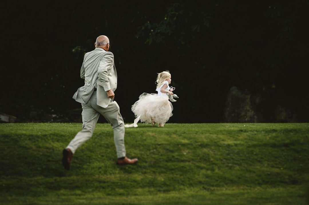 man running after flower girl at brackenborough hotel weddings