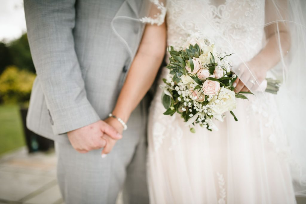brie and groom holding hands