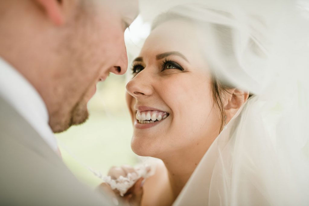 bride looking into grooms eyes