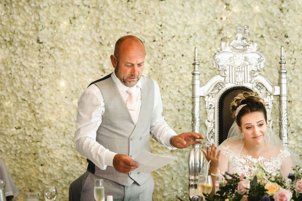 father of bride in grey waistcoat giving speech