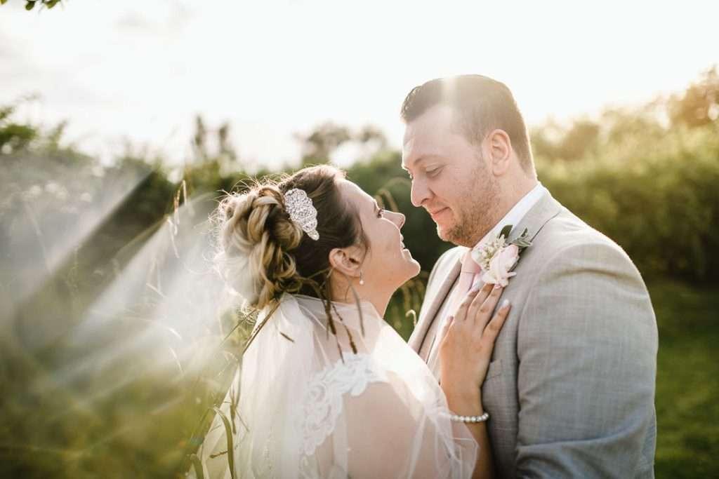 bride looks in to grooms eyes